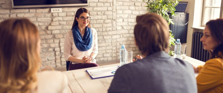 Young female on job interview with commission
